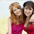 Two teenage girls listening to MP3 player — Stock Photo #6124535