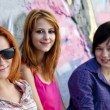 Girlfriends near graffiti wall. - Foto de Stock