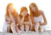 Portrait of three beautiful girls at the beach. — Stock Photo