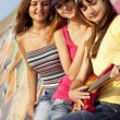 Stockfoto: Three beautiful girls with guitar and graffiti wall at backgroun