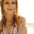 Portrait of red-haired girl in bikini near sea. Photo is with su — Stock Photo