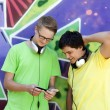 Two friends listening music near graffiti wall. — Stockfoto #6177909