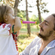 Father and daughter in the park. — Stock Photo