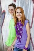 Teens near graffiti wall. — Stock Photo