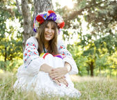 Girl in national slavic costumes at outdoor. — Stock Photo