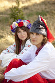 Slav girl with wreath and young cossack at nature — Stock Photo