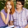 Two students at outdoor doing homework. — Stock Photo