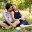 Stock Photo: Young couple in love kissing outdoors.