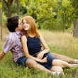 Young couple in love kissing outdoors. — Stock Photo