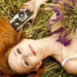 Redhead girl with vintage camera at outdoor. — Stock Photo