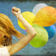 Redhead girl with colour balloons at blue sky background. — Stock Photo