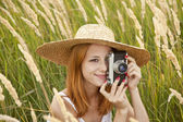 Redhead girl with old camera at outdoor. — Stock Photo