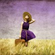 Royalty-Free Stock Photo: Lonely girl with suitcase at country.