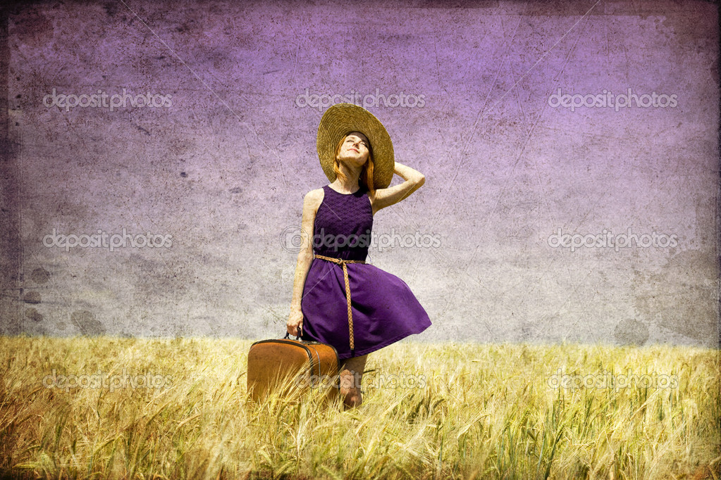 Lonely girl with suitcase at country. Photo in old color image style. — Stock Photo #6448815