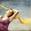 Young woman with open arms keep yellow silk on wind. — Stock Photo
