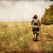 Redhead girl with cycle. — Stock Photo