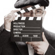 Old fashioned man and movie clapper - Stock Photo