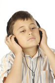 Boy with headphones listening to music — Stock Photo