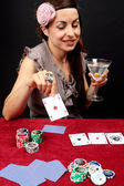 Woman gambling at the casino — Stock Photo