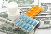 Pills and dollar bills — Stock Photo