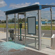 Vandalised bus stop. - Stock Photo