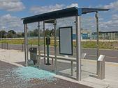 Vandalised bus stop. — Stock Photo