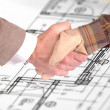 Worker and businessmshaking hands over house renovation plans — Stok Fotoğraf #5616938