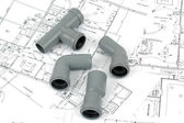 PVC fittings for drainage with plumbing plans — Stock Photo