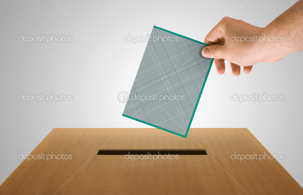 Human hand insert the electoral document on urn for voting — Stock Photo #5655359