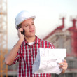 Architect working outdoors on a construction — Stock Photo
