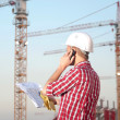 Architect working outdoors on a construction — Stockfoto