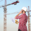 Architect working outdoors on a construction site — Stock Photo