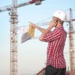Architect working outdoors on a construction site - Stockfoto