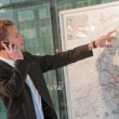 Young business man looking a map — Stock Photo #5594827