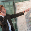 Young business man looking a map — Stock Photo