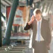 Young business man with a telephon — Stock Photo