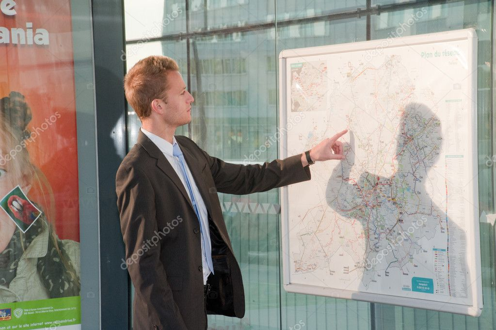 Young business man looking a map — Stock Photo #5594796