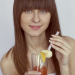 Portrait of happy smiling woman drinking fresh juice — Stock Photo #5390614