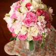 Bridal bouquet of pink and white roses on the table — Stock Photo