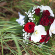 Bridal bouquet in the grass — Stock Photo