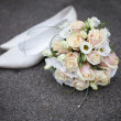 Wedding background from bouquet and shoes bridge — Stock Photo