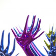 Stock Photo: Statuette colored hands
