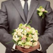 The groom is holding a wedding bouquet — Стоковая фотография
