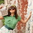 Girl with a suitcase in the glasses in restro image — Stock Photo
