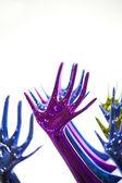 Statuette colored hands — Stock Photo