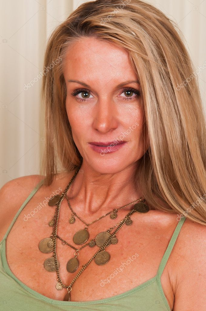 Beautiful mature blonde in a green tank top