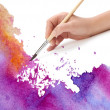 Hand with brush and watercolor paint — Stock Photo