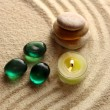 Stock Photo: Stones and light candle