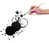 Hand with brush and abstract blot — Stock Photo