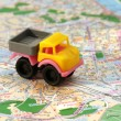 Small car on map — Stock Photo